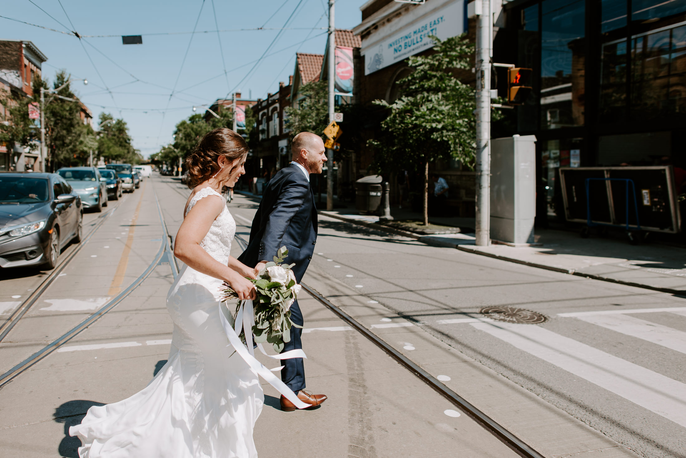 Bride and Groom running across the street