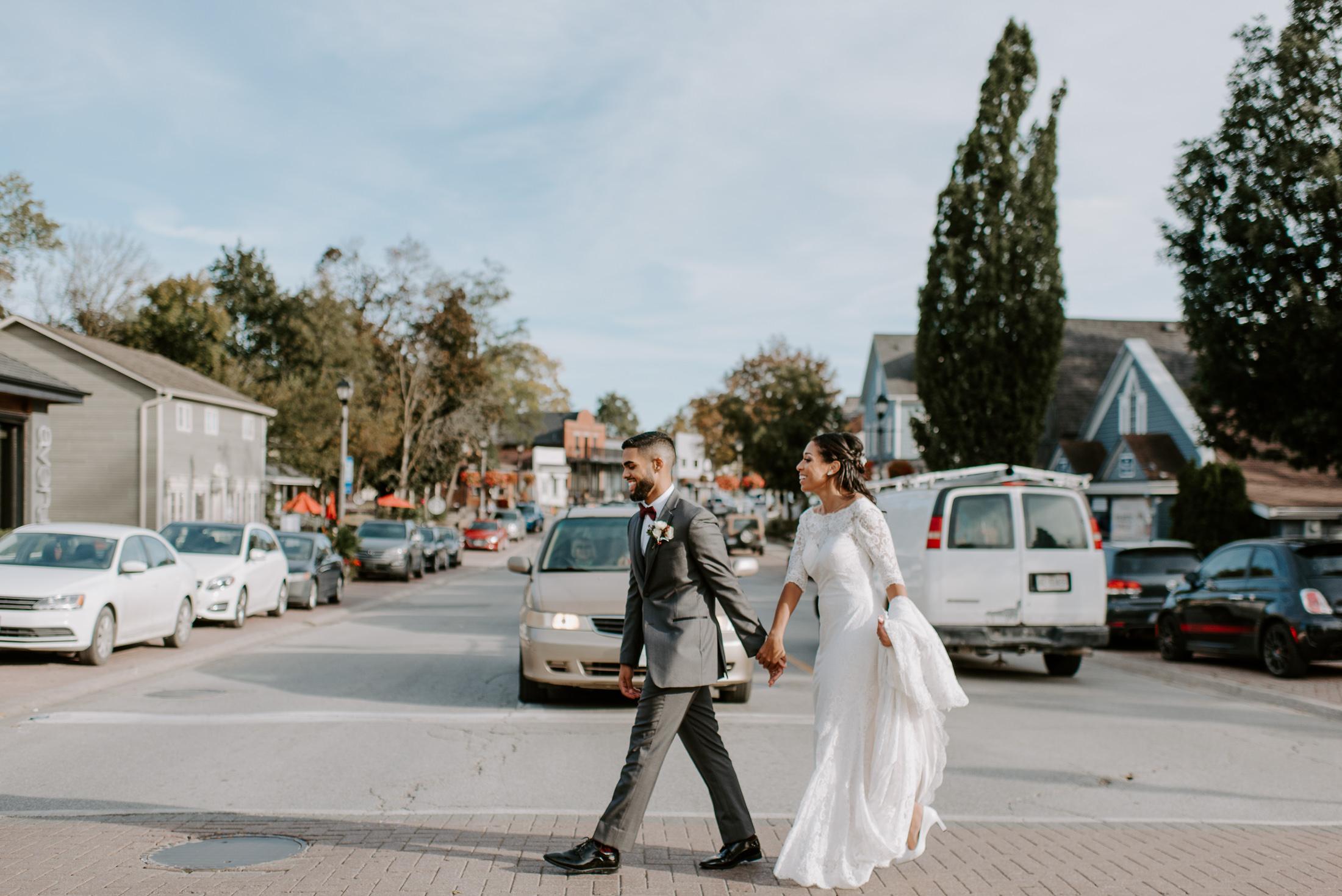 Bride and Groom Walking Across the street